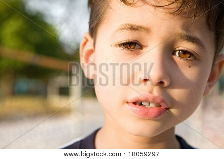 Closeup of a young boy while storytelling showing facial expression and lovely eye contact.