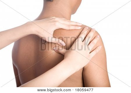 Man receiving massage on back of shoulder due to injury.
