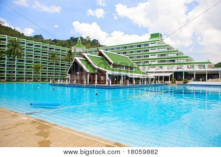 Vast warm tropical pool by a resort hotel in Phuket, Thailand