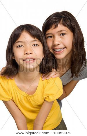 Two young sisters of mix parentage enjoying happy moments together.