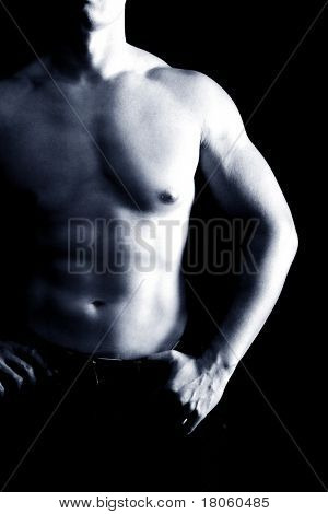 Man's body with well define and sculpted abs, chest and arms.