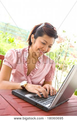 Young businesswoman on laptop, working from home