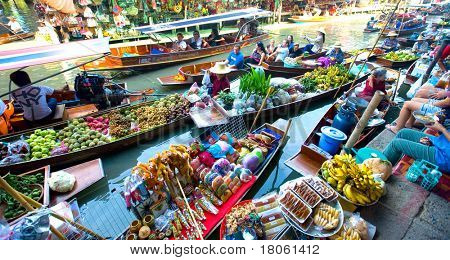 Bangkok August 2008. Busy sunday morning at Damnoen Saduak floating market, Bangkok Thailand of locals selling fresh produce, cooked food and souvenirs.
