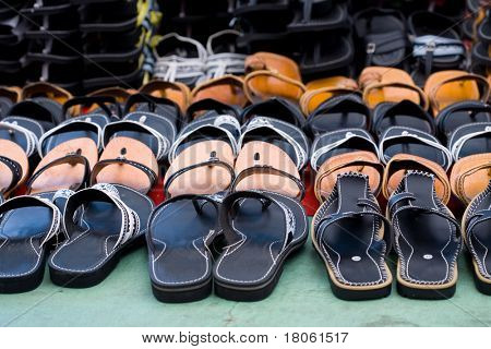 Rows of '' chapal '' or slipper made out of leather. A traditional footwear for the Malay men in Asia.