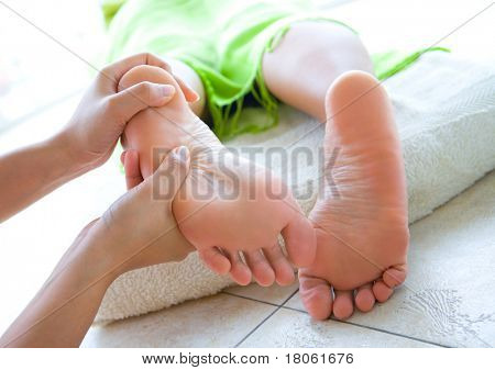 Woman having foot reflexology