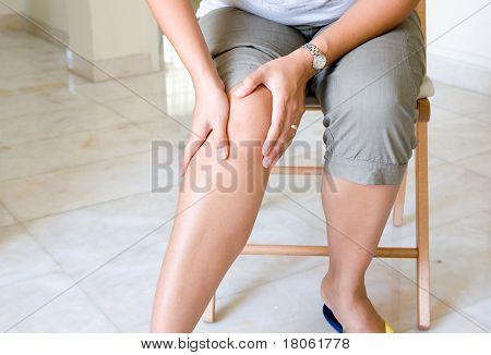 Woman suffering from pain in knee