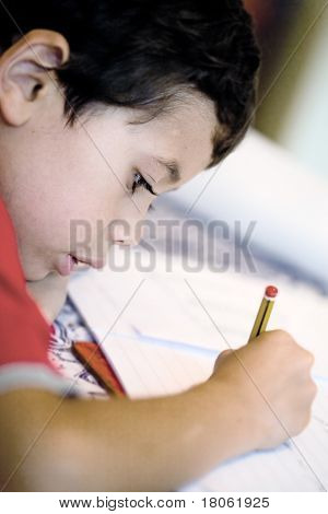 Young boy enjoying his his writing as part of homework