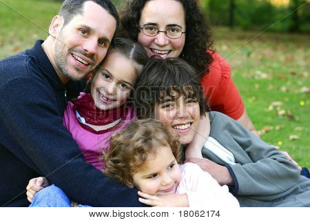 Beautiful family having fun in an outdoor park