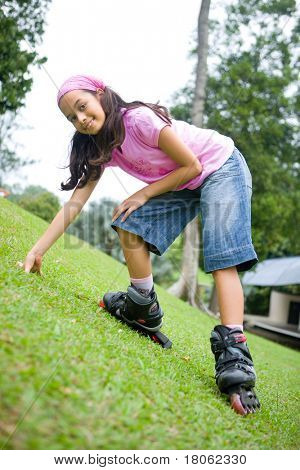 Young girl enjoying the outdoor park in her rollerblade