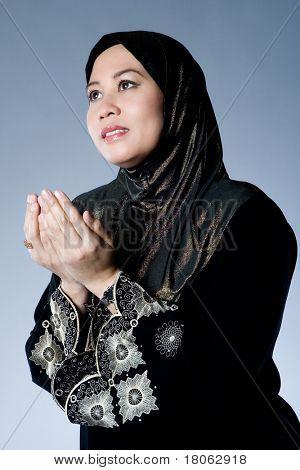Muslim woman praying and hoping