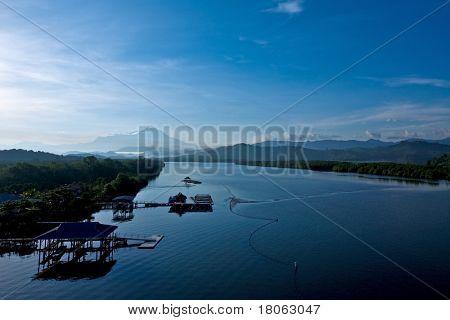 Mount Kinabalu in the horizon as seen from the highway bridge in Sabah.
