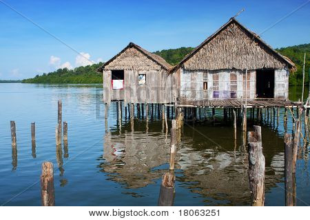 A traditional sea bajau home made out of wooden planks and thatched roofs found in a water's village near Tuaran, Sabah Malaysia