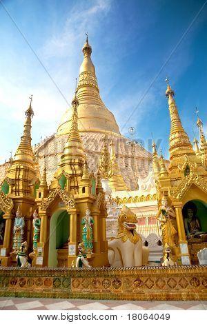 Central pagoda surrounded by hundreds of smaller shrines of Shwedagon pagoda, Yangon, Myanmar.