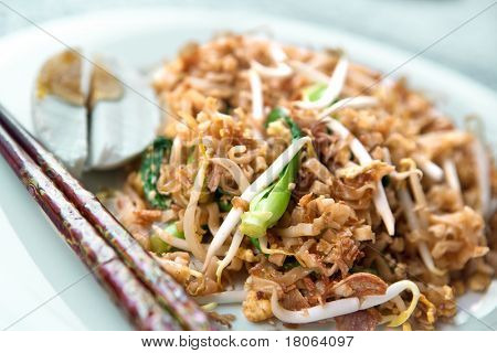 Delicious stir fried oriental noodles with baby bok choi and bean sprouts.