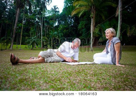 Beautiful senior couple enjoying the summer park