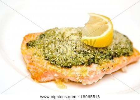 Salmon steak with basil pesto and breadcrumbs sprinkled with parmesan cheese