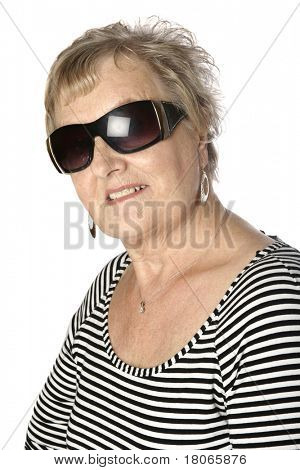 Beautiful caucasian female senior in stripy top and cool shades