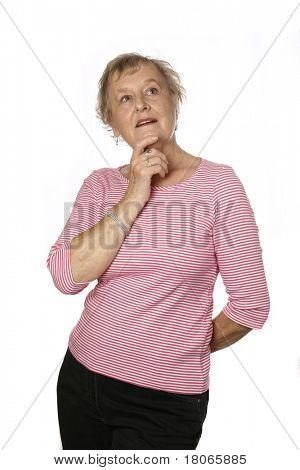Beautiful caucasian female senior in pink top in thinking gesture