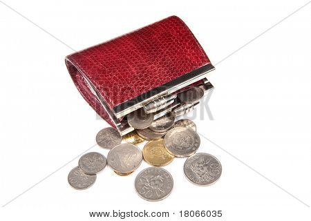 Loose change scattered out from red purse
