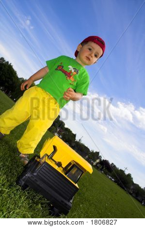Child Playing With Truck