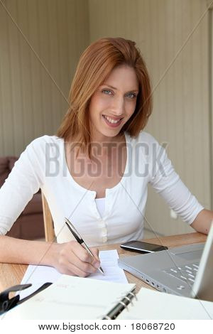 Woman working at home on laptop computer