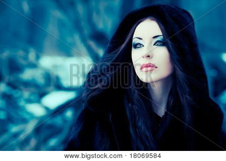 Shot of a gothic woman in a winter park. Fashion.