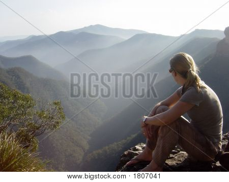 Hiker Overlooking A Valley