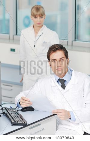 science and research biology chemistry and medicine  youn people couple in bright modern  lab
