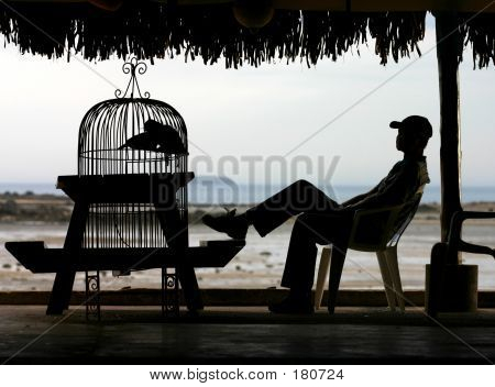A Man Sitting By The Sea