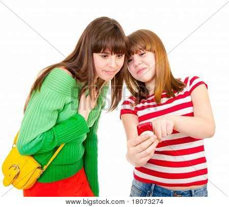 Two Schoolgirls Watching Something In The Mobile Phone