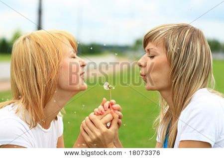 Two Girls On The Green Grass.