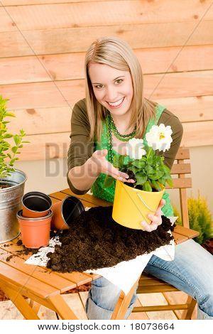 Gardening Woman Planting Spring Flower