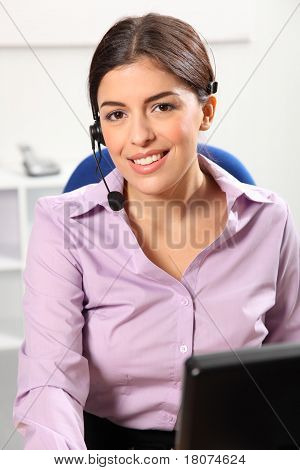 Smiling receptionist in office