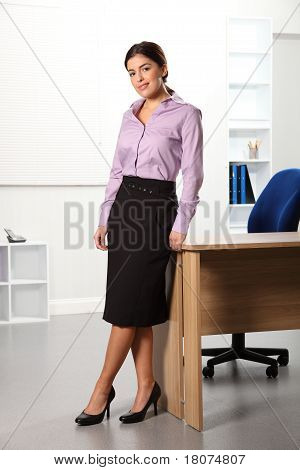 Business woman standing at desk