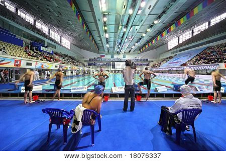 MOSCOW - OCTOBER 5: Swimmers prepare to start in swimming championship 2010 in Olympic sporting complex on October 5, 2010 in Moscow, Russia.