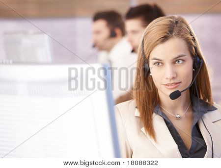 Portrait of beautiful female dispatcher working in call center.?