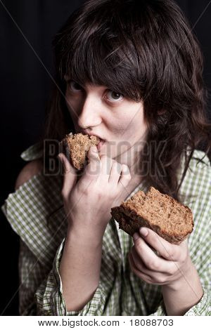 Beggar Woman Eating Bread