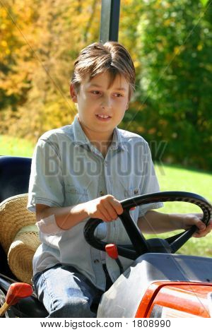 Child On A Small Tractor