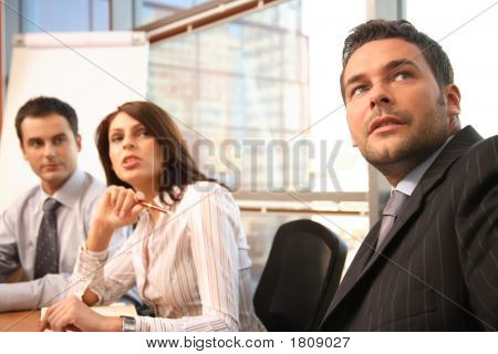 Group Of Business People At The Business Meeting - 2 Men And 1 Woman