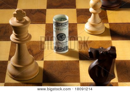 Chess with dollar and euro banknote.
