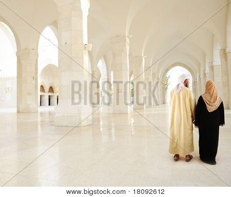 Muslim Arabic couple indoor, White mosque