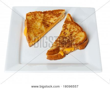 Grilled Cheese Sandwich On White Plate