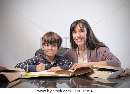 Smiling woman and child doing homework
