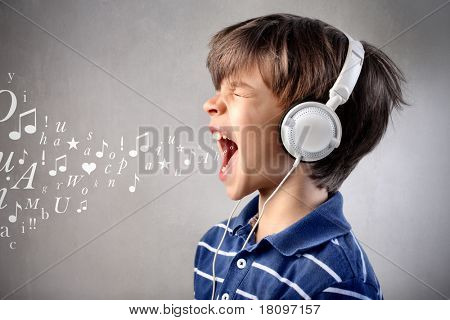 Child singing out loud while listening to music
