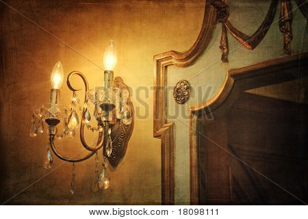 Antique wall light sconce with mirror and vintage background