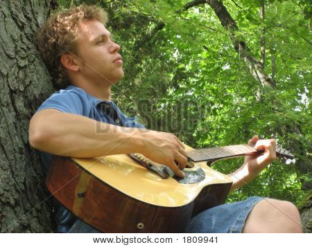 Guitar Player In The Trees