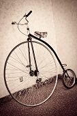 pic of penny-farthing  - Side view of vintage looking Penny Farthing bicycle - JPG