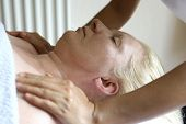 stock photo of therapist massage  - A massage therapist giving a shoulder massage to a client - JPG
