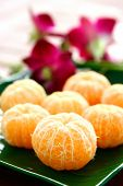foto of satsuma  - Peeled satsumas served on a dish - JPG