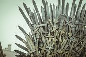Iron throne made with swords, fantasy scene or stage. Recreation of a medieval seat poster